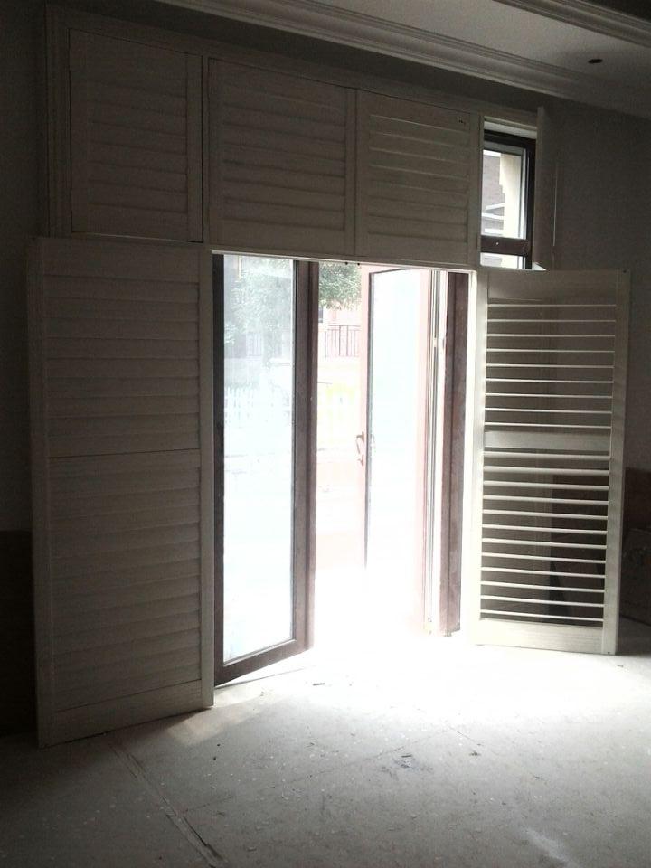 葫芦岛实木折叠门厂家定制18012943949